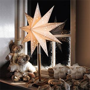 Spred hygge i vinduet med julestjerner